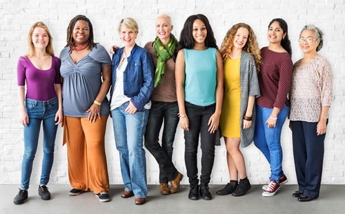 Diverse group of women standing in a row